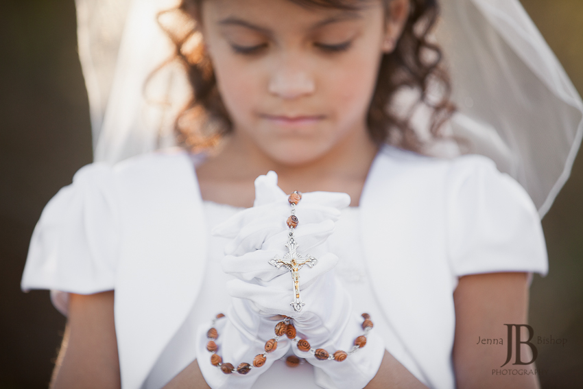 First communion and confirmation holding rosary