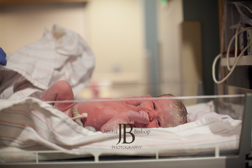 new baby being cleaned up for the first time birth photography