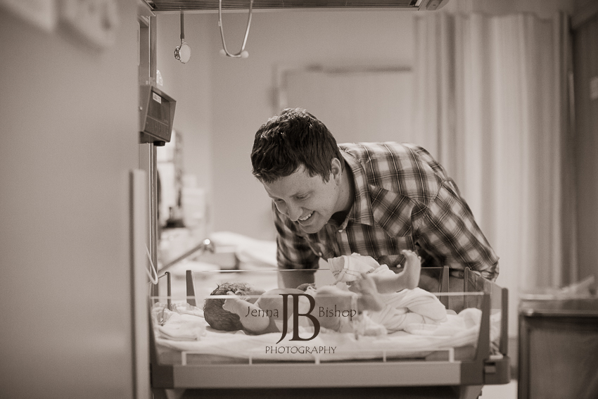 daddy looking at new baby gilbert birth photography