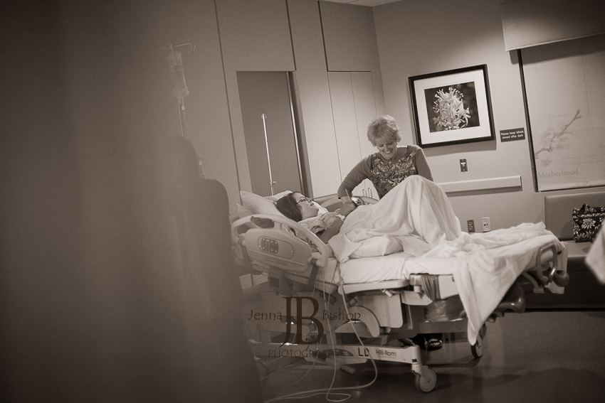 mom at her bedside during labor birth photography