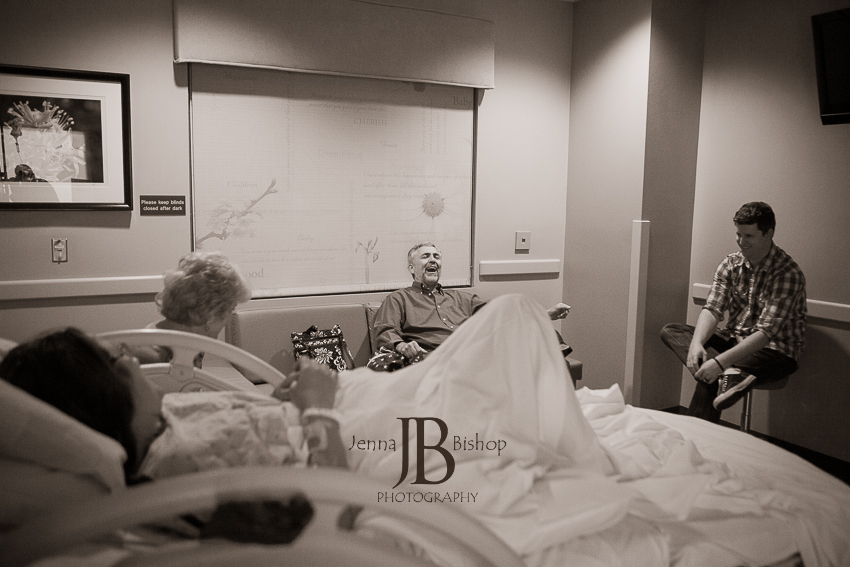 dad laughing during labor birth photography