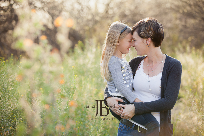 sweet mother and daughter in a field