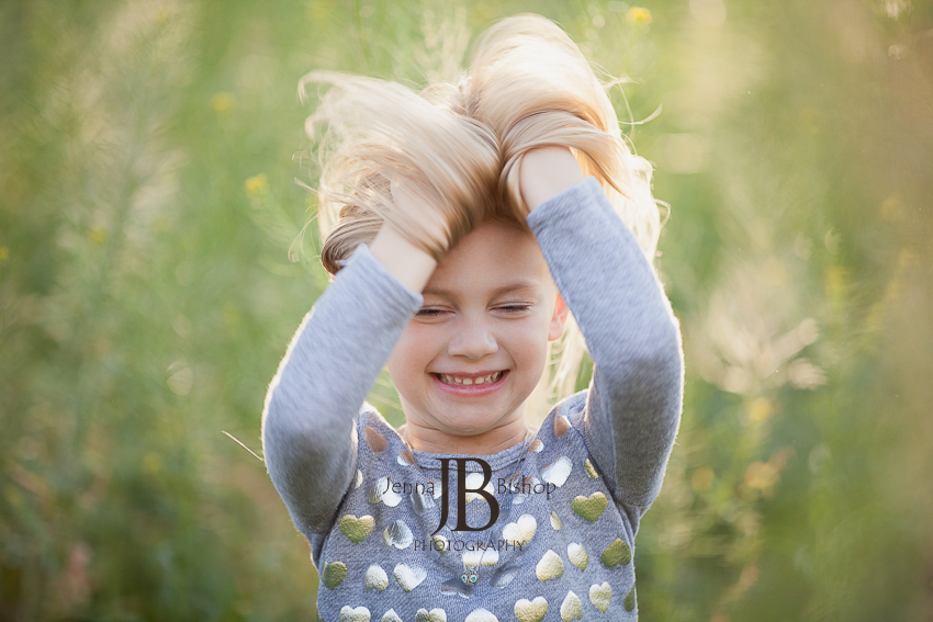 little girl playing with hair and smiling gilbert az