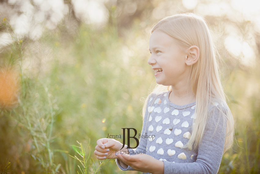 little girl smiling and laughing in the sun