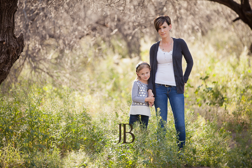 serious mother and daughter in the forest
