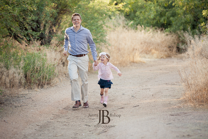 dad running with sweet daughter