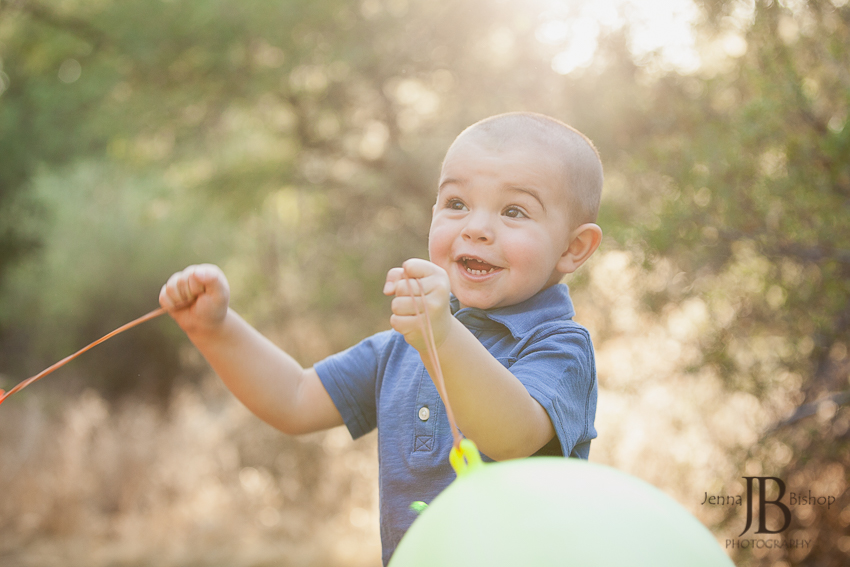 little boy with baloons