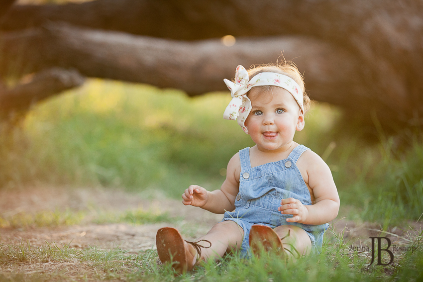 little girl with adorable overalls