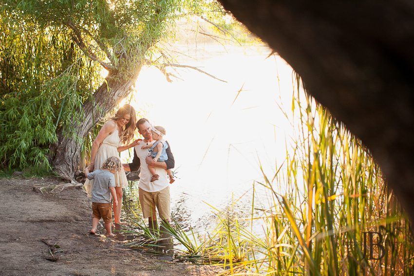 young family playing by the river in mesa arizona